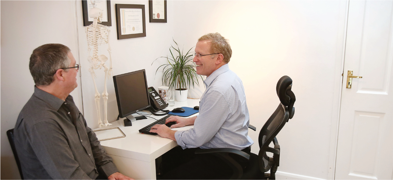 Dominic Metcalfe, Chiropractor with patient at The Chiropractic Clinic New Malden